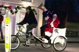 santa arrives in true beacon style for bicycle tree lighting