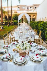 wedding reception decoration outdoor reception decor with white linen and candlesticks
