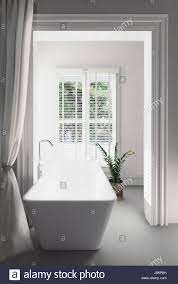 Modern White Bathrooms by Bright Airy Modern White Bathroom Interior With A Rectangular Tub
