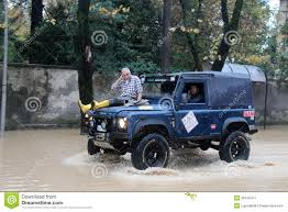 jeep water man saved from the waters on the hood of a jeep in marina di