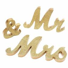 us mr and mrs letters sign standing top table wedding home party