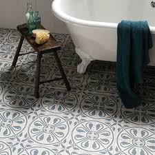 patterned bathroom floor tiles brown cabinet hardware room