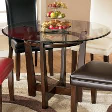 Circle Glass Table And Chairs Ashley Signature Design Charrell Round Glass Top Table Rooms And