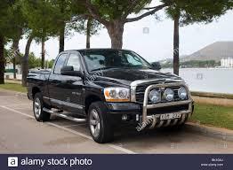 Dodge Ram Pickup Truck - black dodge ram 1500 hemi pickup truck parked in a car park in