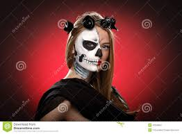 young halloween background young woman in day of the dead mask skull face art stock photo