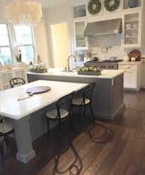 kitchen island dining white shaker waypoint cabinets designed by nathan hoffman if
