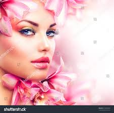 professional make up beauty girl orchid flowersbeautiful model woman stock photo