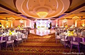 wedding reception venues indian wedding in bright yellow by harvard photography