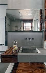 a concrete sink and a wooden sink holder look chic and textural