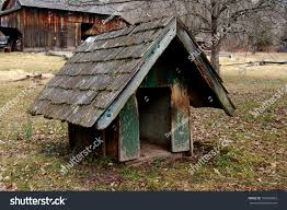 small wooden doghouse shingles on roof stock photo 106635803