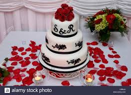 wedding cake roses chocolate wedding cake with roses petals and candles at