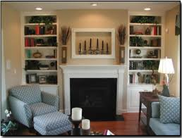 two floor to ceiling built in bookcase with cabinet doors around