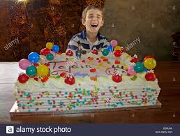 child with giant birthday cake stock photo royalty free image