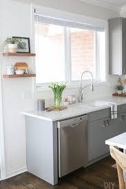 gray kitchen white cabinets white gray kitchen with brass hardware the diy playbook