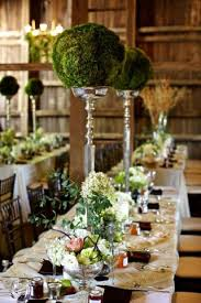 Topiary Balls With Flowers - elegant eco friendly reception with moss ball topiary centerpieces