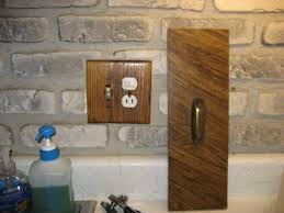 gray white brick wall back splash with brown wooden wall jack as