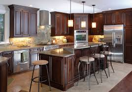 dark cherry wood kitchen cabinets brown wooden laminate flooring