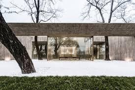 arch studio carves concrete buddhist shrine into a grassy mound in