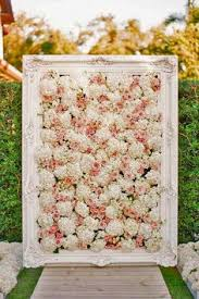 wedding backdrop flower wall wedluxe the wore a custom dress at this