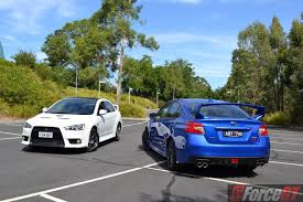 slammed subaru wrx head to head subaru wrx sti vs mitsubishi lancer evo x final edition