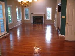 Shining Laminate Wood Floors Decoration Empty Living Room With Fireplace And Chandeliers And