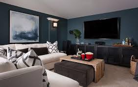 pictures of family rooms with sectionals family room with peacock blue walls and white armless sectional