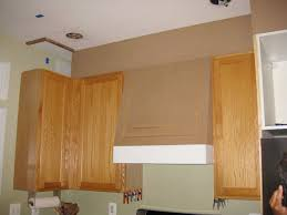 adding cabinets on top of existing cabinets closing the space above the kitchen cabinets remodelando la casa