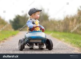 kid play car happy little boy driving big vintage stock photo 328254116