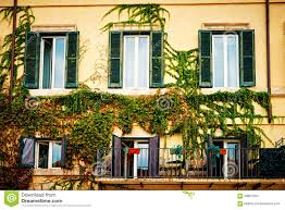 balconies full of flowers decorate houses in rome italy stock
