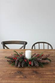 5 minute diy christmas centerpiece with pinecones u0026 berries