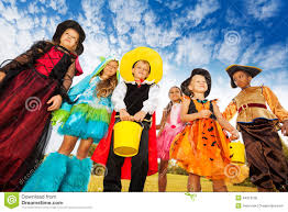 group of kids in halloween costumes looks down stock photo image