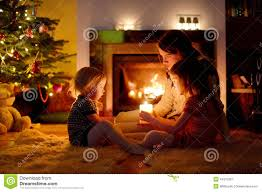 happy family by a fireplace on christmas stock image image 44270367