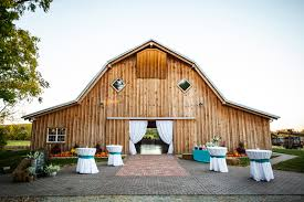 wedding venues in kansas outdoor wedding cocktail hour barn as a backdrop real wedding by