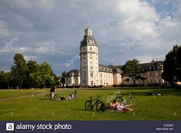 Karlsruhe Baden Baden People Sunbathing On The Lawn In The Park In Front Of Karlsruhe