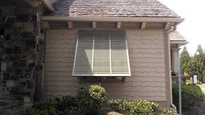 decorating cool beige wood siding with bahama shutters lowes for