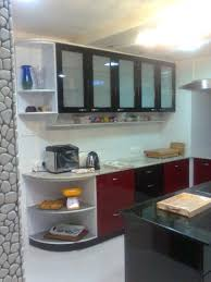 living black laminated wooden kitchen island with red stained