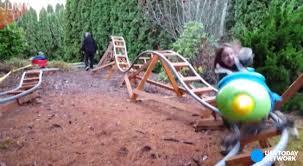 backyard theme park awesome dad builds backyard theme park
