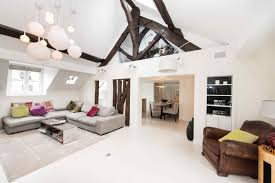 renovated apartment with high ceilings exposed beams and hammam