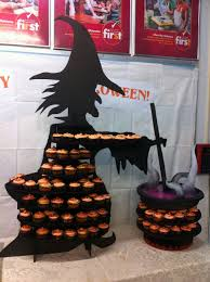 halloween witch and caldron cupcake display same idea but with