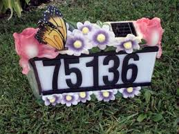 solar house number light with butterfly and flowers green garden