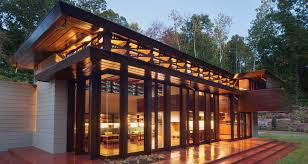 frank lloyd wright inspired home with lush landscaping mid century modern homes contemporary style houses
