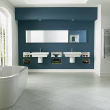 cool bathroom with wall sinks and porcelain bathtub also diagonal