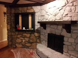 stone fireplace before and after crux grey paint wash on a brick