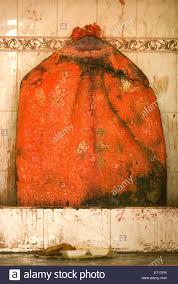 orange colour stone statue lord hanuman maruti pavan putra