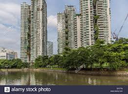 apartment buildings with vertical gardens facing the singapore