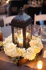 white lantern centerpieces black lantern and white hydrangea centerpiece