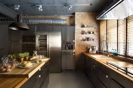 modern nice design of the industrial kitchen that has black floor