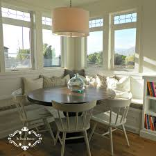 farmhouse kitchen with round breakfast nook plus white curved back