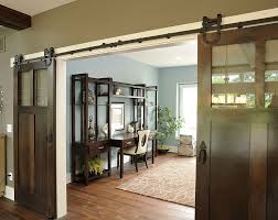 industrial barn style doors conceal a spacious and traditional