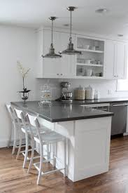 this is it white cabinets subway tile quartz countertops white cabinets gray counters wood floors breakfast bar island don t like the open cabinet but this layout fits the kitchen currently